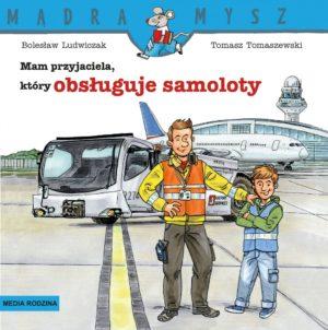 Koordynator obsługi naziemnej Piotr, chłopiec i samolot